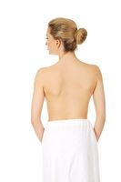 Young topless woman back after spa or bath.