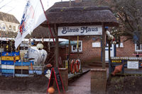 Fishing crates, buoys and other maritime objects in front of the old bar Blaue Maus on the North Fri