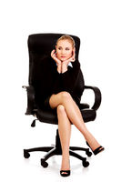 Tired or worried business woman sitting on armchair