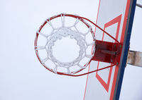Basketball hoop with net, covered by hoarfrost