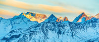 Mountains peaks with snow at sunset