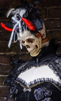 Female mannequin with gothic clothes, skull and red horns