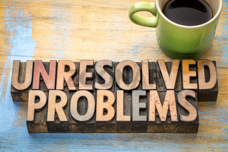 unresolved problems - word abstract in wood type