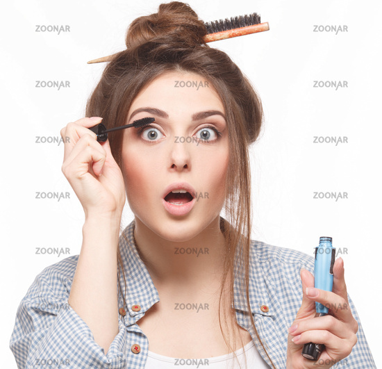 Woman with hairstyle doing makeup