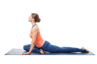 Woman doing yoga asana Eka pada kapotasana
