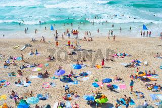 People at ocean beach. Portugal
