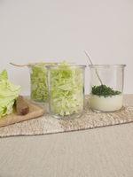 Napa cabbage salad in glass with yogurt dressing