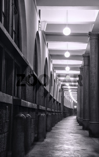 Long passage with elegant columns and lights