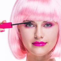 Glamour girl using mascara