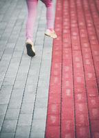 Little girl running on the pavement