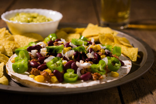Mexican tortillas with meat, red beans, Jalapeno pepper and nachos chips