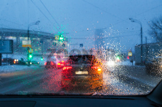 blurred background with drops on the windshield