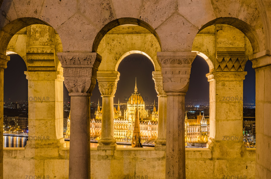 Night view of the Hungarian Parliament Building in Budapest, Hungary.
