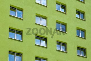 green building exterior , windows on house facade