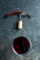 Corkscrew and red wine.