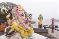 Hindu statues in the mist