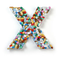 Letter X. Set of alphabet of medicine pills, capsules, tablets and blisters isolated on white.
