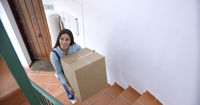 Attractive young woman moving house