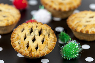 Lattice top mince pies against a christmas background