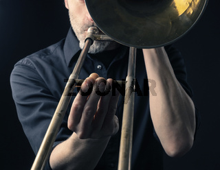 Playing trombone, close up shot