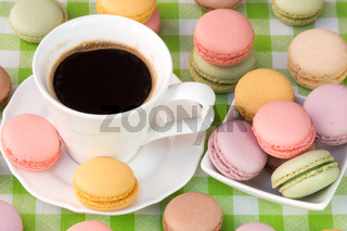 Macaroons with cup of black coffee