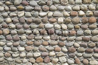 Mauer mit Kieselsteinen