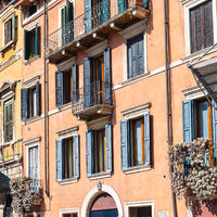 facade of old apartment houses in Verona city