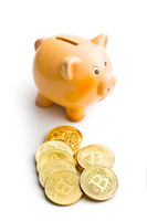 Golden bitcoins. Cryptocurrency and piggy bank.