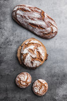 Delicious freshly baked bread on rustic background