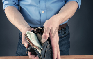Businessman with an open wallet