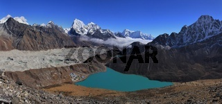 Turquoise Gokyo lake, Ngozumpa glacier and high mountains of the Himalayas, Nepal.
