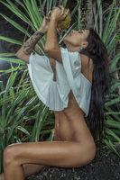 Beautiful brunette woman in the jungle