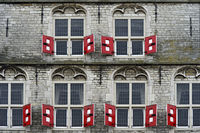 Red shutters at the gothic city hall, Stadhuis, of Gouda, Netherlands