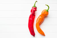 Orange and red peppers.