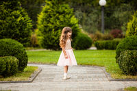 Girl running along the alley
