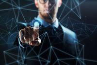 businessman with virtual network hologram