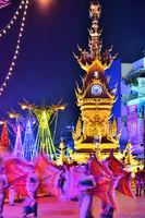 Golden Clock Tower in Chiang Rai, Thailand after sunset.