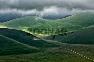 The hills of Castelluccio during a thunderstorm