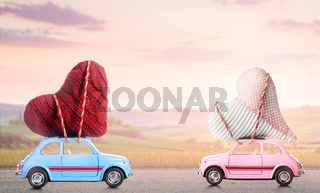 Couple of retro toy cars with Valentine hearts