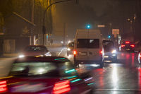 Flowing traffic over a crossroad in the evening rush hour.