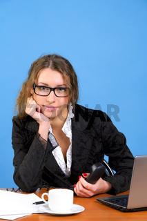 Beautiful businesswoman holding phone