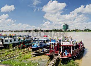 tourist river tour boats in riverside phnom penh city cambodia