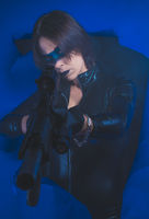 Soldier, Brunette girl dressed in leather and latex fitted with pistol on blue background