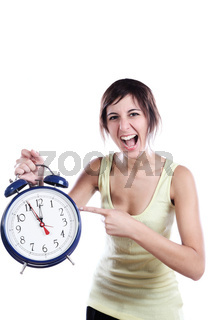Expressive Young Woman Holding A Big Alarm Clock And Pointing The Time