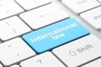 Politics concept: International Law on computer keyboard background