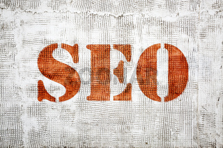 SEO sign painted on grunge stucco texture wall