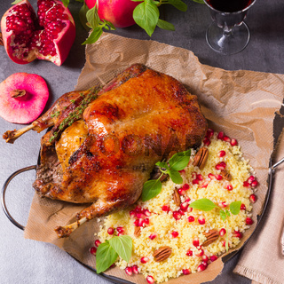 Duck with millet and pomegranate