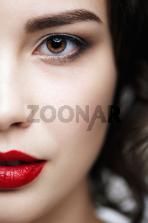 Closeup macro portrait of female face. Human woman half-face  with day beauty makeup