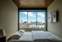Hotel room with Rotterdam city cityscape skyline with Willemsbrug bridge in window