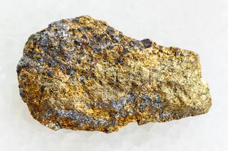 rough pyrite ore on white marble